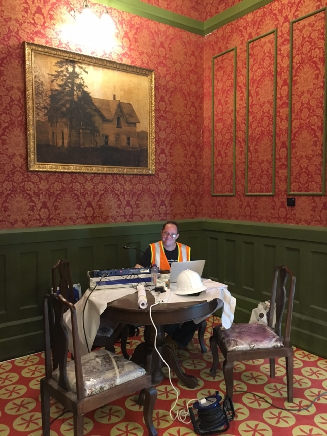 Me happy as can be at my desk in the Haunted Hotel